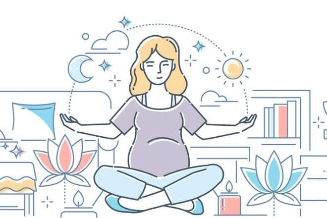 a pregnant woman practicing meditation to calm anxiety during pregnancy